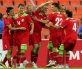 Belarus' Kornilenko celebrates with teammates after scoring against Luxemburg during their Euro 2012 Group D qualifying soccer match in Minsk