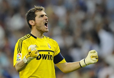 Real Madrid's goalkeeper Casillas celebrates his team's second goal against Barcelona during their Spanish Supercup first leg soccer match in Madrid